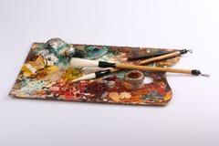 brushes paletten arkivfoto
