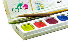 Brushes and pencil in water color box on white background Royalty Free Stock Image