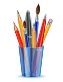 Brushes, pencils and pens in the holder. Royalty Free Stock Photography