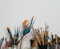 Brushes in pots. Brushes and pens in pots over white background Stock Image