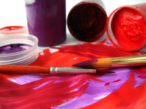 Brushes and red paint jar Stock Photo