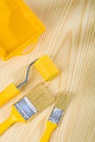 Brushes and roller with paint can Stock Image