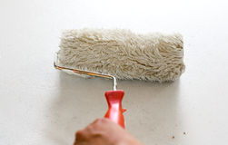 Brushes and rollers for paint on wall Royalty Free Stock Images