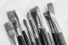 Brushes. Several different size brushes on table Stock Photos