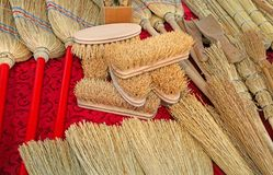 Brushes and small brooms in sorghum. Many brushes and small brooms in sorghum for sale at market royalty free stock photos