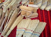 Brushes and small brooms in sorghum for sale. Brushes and brooms in sorghum for sale at market stock photos