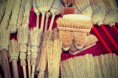Brushes and brooms in sorghum for sale at market with vintage ef. Brushes and small brooms in sorghum for sale at market with vintage effect royalty free stock images