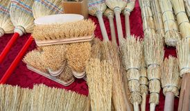 Brushes in sorghum for sale at market. New brushes and brooms in sorghum or broom-corn for sale at market royalty free stock photo