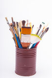 Brushes on the tin can Stock Photos