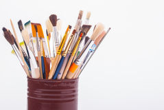 Brushes on the tin can Stock Photography