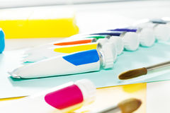Brushes and tubes of oil paint laying on the table Royalty Free Stock Photography