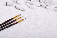 Brushes and tubes of paint on canvas Royalty Free Stock Images