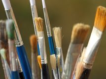 Brushes used by a painter in painting workshop Royalty Free Stock Photos