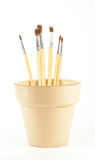 Brushes in vase Stock Images