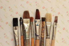 Brushes. On vintage background with flowers Royalty Free Stock Images
