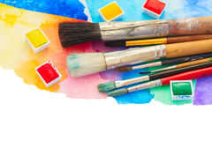 Brushes and watercolor paints border Stock Images