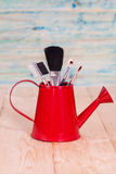 Brushes in watering can Royalty Free Stock Photos