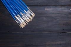 Brushes on wood Stock Photos