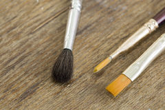 Brushes on a wooden background. Close up royalty free stock images
