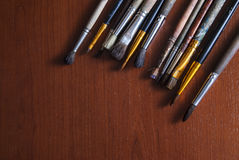Brushes on a wooden surface. On the table Stock Photos