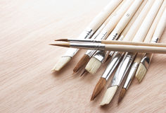 Brushes on wooden table Stock Images