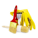 Brushes with yellow gloves and a jar Stock Photo