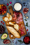 Brushetta or authentic traditional spanish tapas set for lunch table. Sharing antipasti on party picnic time on blue background Stock Images