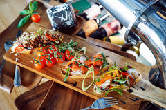Brushetta snacks for wine. Variety of small sandwiches on wooden backdrop. royalty free stock photo