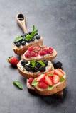 Brushetta or traditional spanish tapas with various berries. Appetizers italian antipasti snacks set stock image