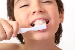 Brushing. Boy with toothbrush close up Stock Photos