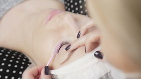 Brushing eyelashes stock footage
