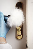 Brushing of fingerprints on door handle. Place of crime - collecting of dactyloscopy evidence after housebreaking Royalty Free Stock Photos