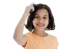 Brushing Hair Stock Photography