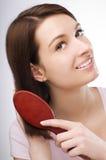 Brushing hair Stock Images