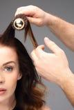 Brushing hair. Stock Photos