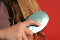 Brushing hair closeup Stock Photography