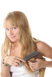 Brushing hairs Royalty Free Stock Image