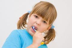 Brushing my teeth. Cute, little girl brushing her teeth stock photography