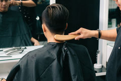 Brushing off excess hair Royalty Free Stock Photography