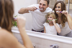 Brushing our teeth. Keeping your teeth in good condition Royalty Free Stock Image
