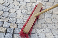 Brushing paving works with new granite stones Stock Photography