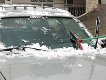 Brushing Snow Off of Windshield Stock Image