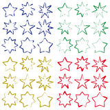 Brushing stars in four colours Stock Photo