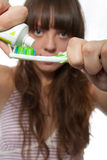 Brushing teeth. The girl squeezes out tooth-paste on a tooth-brush stock images