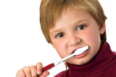 Brushing teeth. Young girl brushing her teeth; 4 years old Royalty Free Stock Photo
