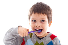 Brushing teeth. Child brushing teeth, looking funny stock photos