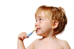 Brushing Teeth. A young boy brushes his teeth stock photography