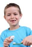 Brushing teeth. 7 years old boy brushing teeth on white stock photography