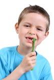 Brushing teeth. 7 years old boy brushing teeth on white stock images