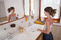 Brushing teeth in bathroom Stock Images
